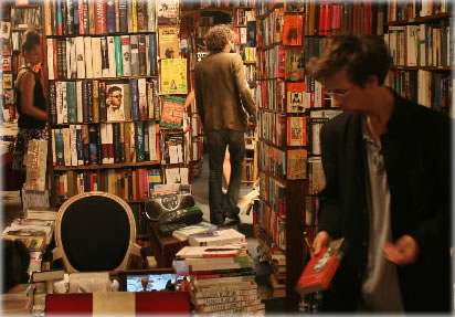 Lara, left, and Jonathan, right, Shakespeare & Co. books, Paris, 2005.